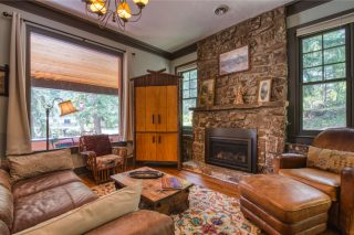 The interior of Zeb's Cabin in Cascade, CO shows the lodging experience in a rustic Colorado cabin.